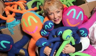 Jane Guinn creator of Stickman Stew dolls prepares her creations for travel at her home in Fulton, Texas, Feb, 13, 2014, to attend the Toy Industry Association's International 2014 Toy Fairin New York. Jane came up with the idea for Stickman Stew back in 1992 while decorating toy bucket. (AP PHOTO/Corpus Christi Caller-Times, Todd Yates)  MANDATORY CREDIT, TV OUT, MAGS OUT  (