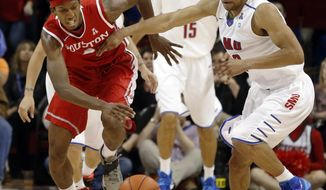 Houston forward Danrad Knowles (0) and SMU guard Nick Russell (12) chase a loose ball during the first half of an NCAA basketball game on Wednesday, Feb. 19, 2014, in Dallas. (AP Photo/John F. Rhodes)