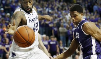 Kansas State forward Thomas Gipson (42) reaches for the ball while covered by TCU forward Brandon Parrish, right, during the first half of an NCAA college basketball game in Manhattan, Kan., Wednesday, Feb. 19, 2014. (AP Photo/Orlin Wagner)