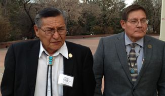 Ben Shelly, the President of the Navajo Nation, left, and Lorenzo Bates, Navajo Council Delegate walk outside the New Mexico Capitol in Santa Fe, N.M., Wednesday, Feb. 19, 2014. The state Senate rejected a proposed gambling compact that would have allowed the Navajos to open three additional casinos over 15 years. The compact needed approval of the Legislature and the U.S. Interior Department to take effect. The Navajos currently have two Las Vegas-style casinos in New Mexico under a compact expiring next year. The state House of Representatives had approved the proposed tribal-state gambling agreement on Tuesday. (AP Photo/Barry Massey)