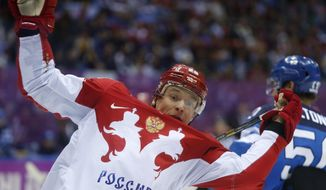 Russia forward Alexander Syomin loses his balance against Finland in the third period of a men's quarterfinal ice hockey game at the 2014 Winter Olympics, Wednesday, Feb. 19, 2014, in Sochi, Russia. (AP Photo/Julio Cortez)