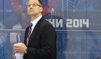 Team USA head coach Dan Bylsma looks up at the scoreboard during the second period of men's quarterfinal hockey game against the Czech Republic at Shayba Arena at the 2014 Winter Olympics, Wednesday, Feb. 19, 2014, in Sochi, Russia. (AP Photo/J. David Ake)