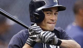 FILE - In this Aug. 21, 2013, file photo, New York Yankees' Ichiro Suzuki warms up for a baseball game against the Toronto Blue Jays at Yankee Stadium in New York. Suzuki has a chance to reach 3,000 hits--he enters the season with 2,742, but he might not get a lot of at-bats in New York. AP Photo/Kathy Willens, File)