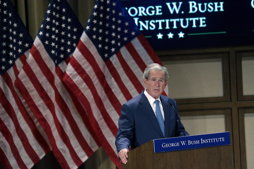 "Former President George W. Bush speaks  during a summit titled ""Empowering Our Nation's Warriors,""  held at the George W. Bush Institute at Southern Methodist University Wednesday, Feb. 19, 2014, in Dallas. Bush's policy institute is hosting the summit on helping veterans transition to civilian life. (AP Photo/LM Otero)"