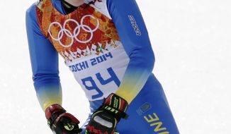 Ukraine's Dmytro Mytsak finishes the first run of the men's giant slalom at the Sochi 2014 Winter Olympics, Wednesday, Feb. 19, 2014, in Krasnaya Polyana, Russia. (AP Photo/Gero Breloer)