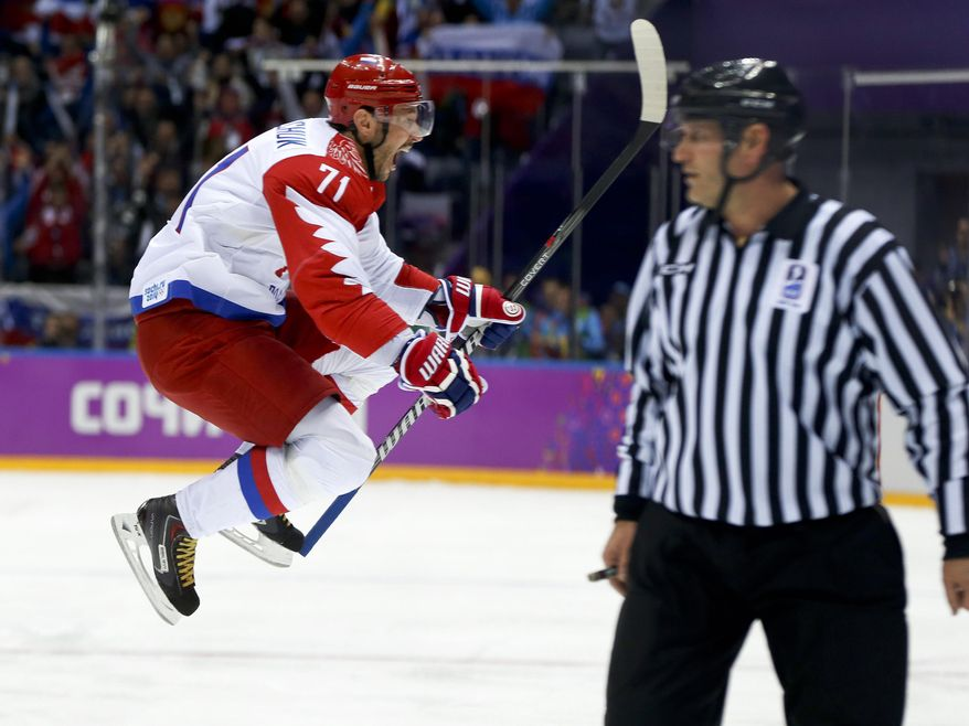 Russia forward Ilya Kovalchuk reacts after scoring a goal against Finland during the first period of a men's quarterfinal ice hockey game at the 2014 Winter Olympics, Wednesday, Feb. 19, 2014, in Sochi, Russia. (AP Photo/Julio Cortez)