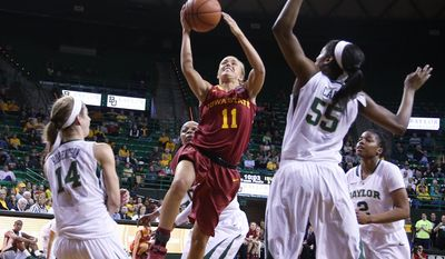 Iowa State guard Jadda Buckley (11), center, shoots between Baylor guard Makenzie Robertson (14), left, and center Khadijiah Cave (55), right, in the first half of an NCAA college basketball game, Wednesday, Feb. 19, 2014, in Waco, Texas. (AP Photo/Rod Aydelotte)
