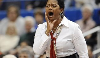 Central Florida coach Joi Williams calls out to her team during the first half of an NCAA college basketball game against Connecticut, Wednesday, Feb. 19, 2014, in Hartford, Conn. (AP Photo/Jessica Hill)