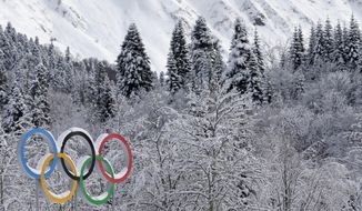 The Olympic rings are covered with freshly fallen snow prior to the cross-country sprint competitions at the 2014 Winter Olympics, Wednesday, Feb. 19, 2014, in Krasnaya Polyana, Russia. (AP Photo/Matthias Schrader)
