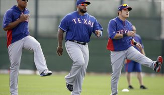 Texas Rangers' Adrian Beltre, left, Prince Fielder and Shin-Soo Choo of South Korea, right, participate in warm ups before a morning workout during spring training baseball practice, Wednesday, Feb. 19, 2014, in Surprise, Ariz. (AP Photo/Tony Gutierrez)