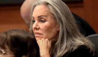 Defendant Pamela Phillips listens to her attorney talk to the jury as opening arguments commence Wednesday, Feb. 19, 2014, in Tucson, Ariz.  Phillips has pleaded not guilty to first-degree murder and conspiracy to commit murder in the 1996 Tucson car bomb killing of her ex-husband.  (AP Photo/Arizona Daily Star, A.E. Araiza)  ALL LOCAL TV OUT; PAC-12 OUT; MANDATORY CREDIT