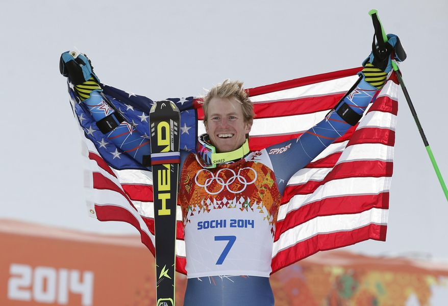 Men's giant slalom gold medalist Ted Ligety of the United States poses for photographers  on the podium at the Sochi 2014 Winter Olympics, Wednesday, Feb. 19, 2014, in Krasnaya Polyana, Russia. (AP Photo/Christophe Ena)