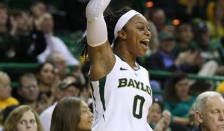 Baylor guard Odyssey Sims (0) celebrates a basket against Iowa State in the second half of an NCAA college basketball game, Wednesday, Feb. 19, 2014, in Waco, Texas. (AP Photo/Rod Aydelotte)