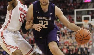 Northwestern's Alex Olah, right, drives to the basket against Ohio State's Trey McDonald during the first half of an NCAA college basketball game Wednesday, Feb. 19, 2014, in Columbus, Ohio. (AP Photo/Jay LaPrete)