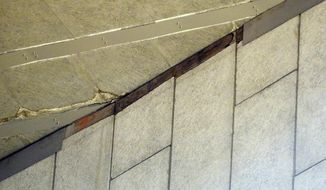 This Tuesday, Feb. 18, 2014 photo shows a section of the facade in the northwest corner of Assembly Hall where a piece of metal fell Tuesday, Feb. 18, 2014, resulting in the postponement of the Indiana Iowa men's basketball game, in Bloomington, Ind. The facade and the metal are purely decorative and serve no weight bearing portion of the roof. (AP Photo/The Herald-Times, Chris Howell)