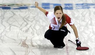Canada's Kaitlyn Lawes shouts instructions to her teammates during the women's curling semifinal game against Britain at the 2014 Winter Olympics, Wednesday, Feb. 19, 2014, in Sochi, Russia. (AP Photo/Wong Maye-E)