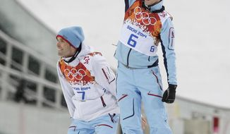 Norway's silver medal winner Magnus Hovdal Moan and Norway's gold medal winner Joergen Graabak, right, celebrate after the flower ceremony of the Nordic combined individual Gundersen large hill competition at the 2014 Winter Olympics, Tuesday, Feb. 18, 2014, in Krasnaya Polyana, Russia. (AP Photo/Matthias Schrader)