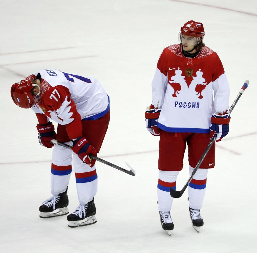 Russia defenseman Anton Belov and Russia forward Viktor Tikhonov react at the end of a men's quarterfinal ice hockey game against Finland at the 2014 Winter Olympics, Wednesday, Feb. 19, 2014, in Sochi, Russia. Finland won 3-1. (AP Photo/Mark Humphrey)