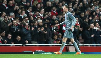 Arsenal's goalkeeper Wojciech Szczesny leaves the pitch after a red card during a Champions League, round of 16, first leg soccer match between Arsenal and Bayern Munich at the Emirates stadium in London, Wednesday, Feb. 19, 2014 .(AP Photo/Alastair Grant)