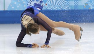Julia Lipnitskaya of Russia falls as she competes in the women's short program figure skating competition at the Iceberg Skating Palace during the 2014 Winter Olympics, Wednesday, Feb. 19, 2014, in Sochi, Russia. (AP Photo/Darron Cummings)