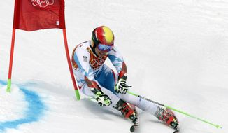 Austria's Marcel Hirscher skis past a gate during  the first run of the men's giant slalom the Sochi 2014 Winter Olympics, Wednesday, Feb. 19, 2014, in Krasnaya Polyana, Russia.  (AP Photo/Charles Krupa)