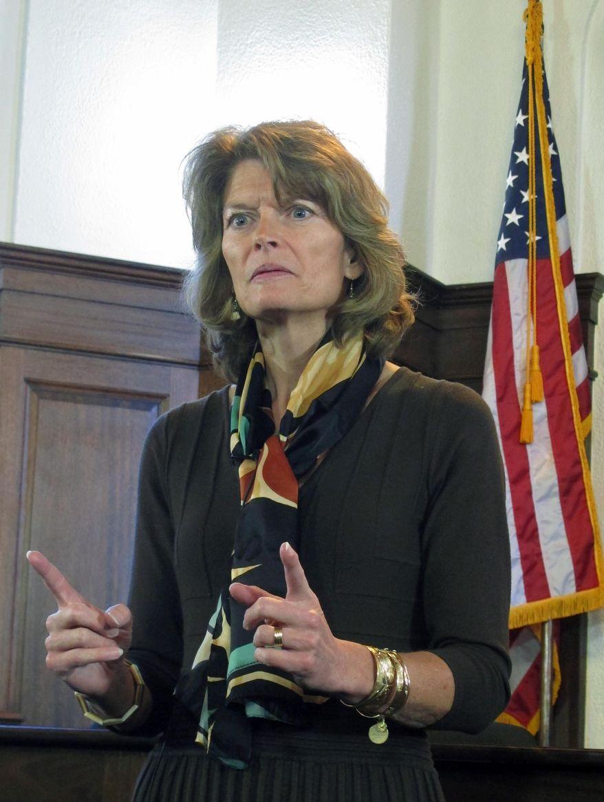 U.S. Sen. Lisa Murkowski addresses reporters during a news conference following her speech to a joint session of the Alaska Legislature on Wednesday, Feb. 19, 2014, in Juneau, Alaska. (AP Photo/Becky Bohrer)