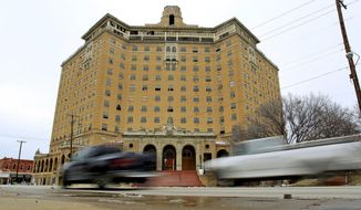 FOR USE SUNDAY FEB. 23 2014 AND THEREAFTER - In this Feb. 7, 2014 photo, traffic moves past the tattered Baker Hotel in downtown Mineral Wells, Texas. The rebirth of the hotel could give an economic boost to the city. (AP Photo/The Fort Worth Star-Telegram, Paul Moseley)  MAGS OUT; (FORT WORTH WEEKLY, 360 WEST); INTERNET OUT