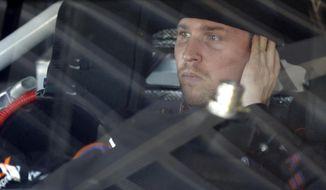 Denny Hamlin looks out from his car before practice for Sunday's NASCAR Daytona 500 Sprint Cup Series auto race at Daytona International Speedway in Daytona Beach, Fla., Wednesday, Feb. 19, 2014. (AP Photo/John Raoux)