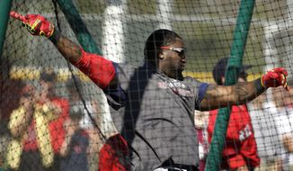 Boston Red Sox designated hitter David Ortiz takes batting practice during spring training baseball practice Tuesday, Feb. 18, 2014, in Fort Myers, Fla. (AP Photo/Steven Senne)