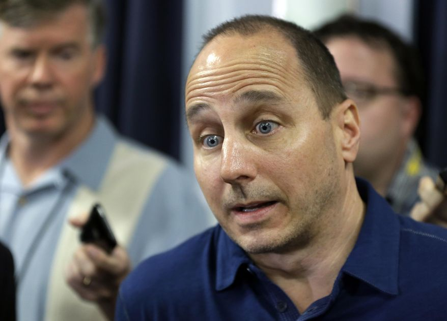 New York Yankees general manager Brian Cashman responds to a question about shortstop Derek Jeter after a news conference Wednesday, Feb. 19, 2014, in Tampa, Fla. Jeter has announced he will retire at the end of the 2014 season. (AP Photo/Chris O'Meara)