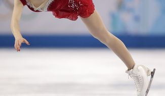 Gracie Gold of the United States competes in the women's short program figure skating competition at the Iceberg Skating Palace during the 2014 Winter Olympics, Wednesday, Feb. 19, 2014, in Sochi, Russia. (AP Photo/Bernat Armangue)