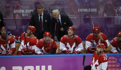 Russian head coach Zinetula Bilyaletdinov talks to players on the bench in the third period of a men's quarterfinal ice hockey game against Finland at the 2014 Winter Olympics, Wednesday, Feb. 19, 2014, in Sochi, Russia. (AP Photo/Mark Humphrey)