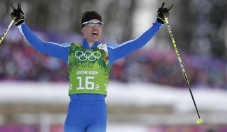 Finland's Sami Jauhojaervi celebrates winning the gold during the men's cross-country team sprint competitions at the 2014 Winter Olympics, Wednesday, Feb. 19, 2014, in Krasnaya Polyana, Russia. (AP Photo/Matthias Schrader)