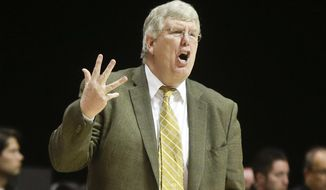 Utah State coach Stew Morrill shouts instructions to his team during the second half of a NCAA college basketball game against San Diego State Tuesday, Feb. 18, 2014, in San Diego. San Diego State won 60-45. (AP Photo/Lenny Ignelzi)