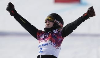 Switzerland's Patrizia Kummer wins her  women's snowboard parallel giant slalom semifinal at the Rosa Khutor Extreme Park, at the 2014 Winter Olympics, Wednesday, Feb. 19, 2014, in Krasnaya Polyana, Russia. (AP Photo/Andy Wong)