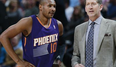 Phoenix Suns guard Leandro Barbosa, left, confers with coach Jeff Hornacek during a timeout against the Denver Nuggets in the first quarter of an NBA basketball game in Denver on Tuesday, Feb. 18, 2014. (AP Photo/David Zalubowski)