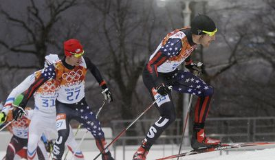 United States' Bryan Fletcher, left, and United Taylor Fletcher ski during the cross-country portion of the Nordic combined individual Gundersen large hill competition at the 2014 Winter Olympics, Tuesday, Feb. 18, 2014, in Krasnaya Polyana, Russia. (AP Photo/Gregorio Borgia)