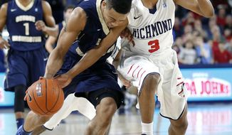 Richmond's ShawnDre' Jones (3) defends George Washington's Joe McDonald (22) during the second half of an NCAA college basketball game Tuesday, Feb. 18, 2014, in Richmond, Va. (AP Photo/Richmond Times-Dispatch,Mark Gormus)