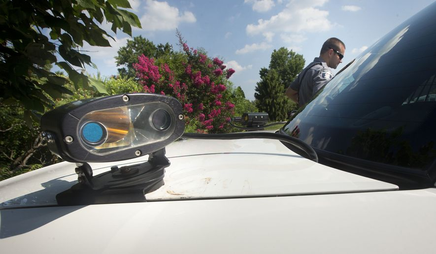 An Alexandria, Va. Police car equipped with license plate scanner, in Alexandria, Va. (AP Photo/Pablo Martinez Monsivais, File)