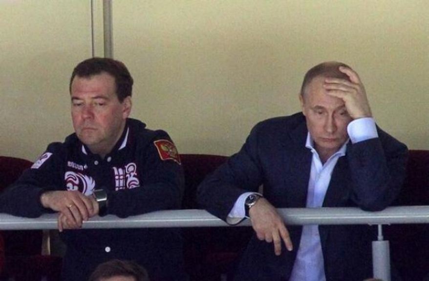 Russia's Dmitry Medvedev and Vladimir Putin in the stands watching the Russian Olympic hockey team. (twitter photo)