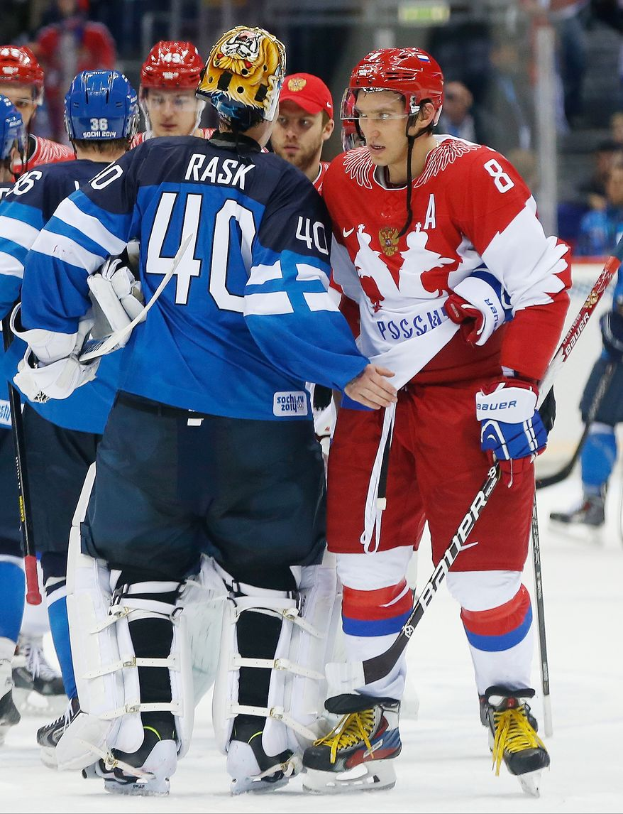 Russia forward Alexander Ovechkin is greeted by Finland goaltender Tuukka Rask after Finland won their men's quarterfinal ice hockey game 3-1 at the 2014 Winter Olympics, Wednesday, Feb. 19, 2014, in Sochi, Russia. (AP Photo/Julio Cortez)