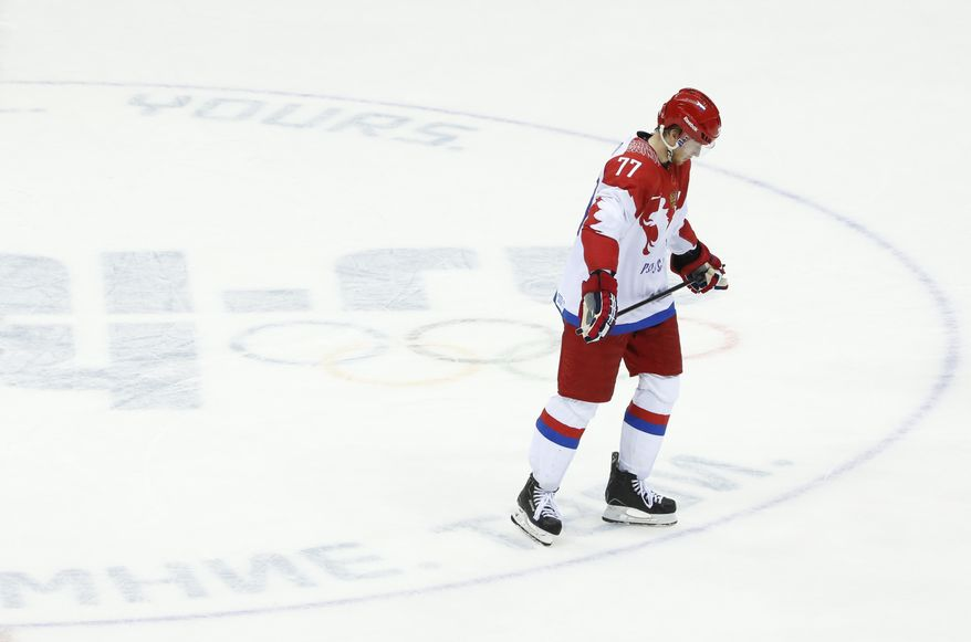 Russia defenseman Anton Belov skates off the ice after Russia lost 3-1 to Finland in a men's quarterfinal ice hockey game at the 2014 Winter Olympics, Wednesday, Feb. 19, 2014, in Sochi, Russia. (AP Photo/Mark Humphrey)