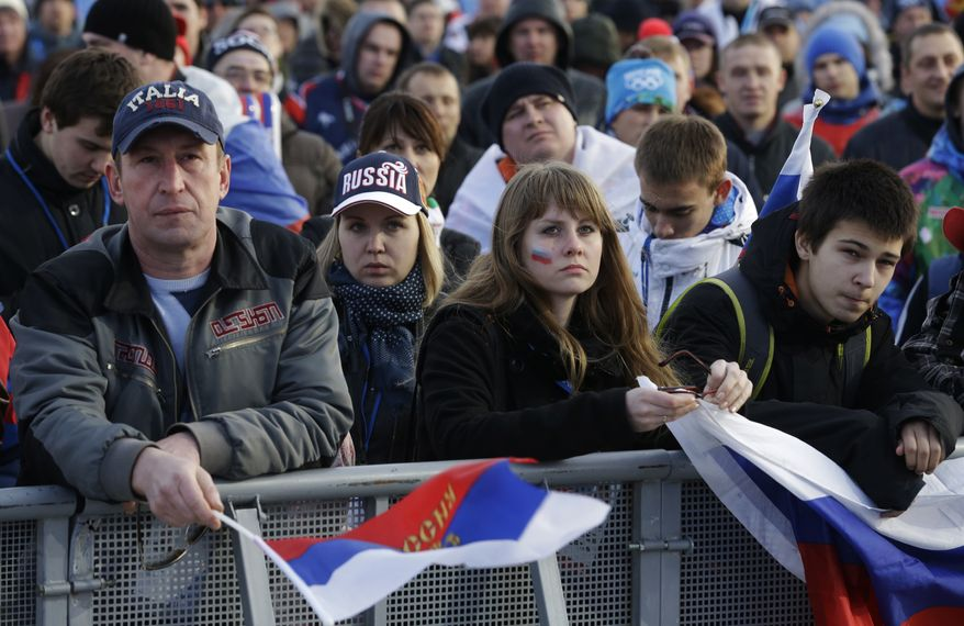 Fans watch the men's ice hockey game between Russia and Finland on a large screen in Olympic Park, at the 2014 Winter Olympics, Wednesday, Feb. 19, 2014, in Sochi, Russia. (AP Photo/Morry Gash)