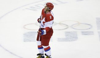Russia forward Alexander Ovechkin skates off the ice after the 3-1 loss to Finland in the men's quarterfinal hockey game in Bolshoy Arena at the 2014 Winter Olympics, Wednesday, Feb. 19, 2014, in Sochi, Russia. (AP Photo/David J. Phillip )