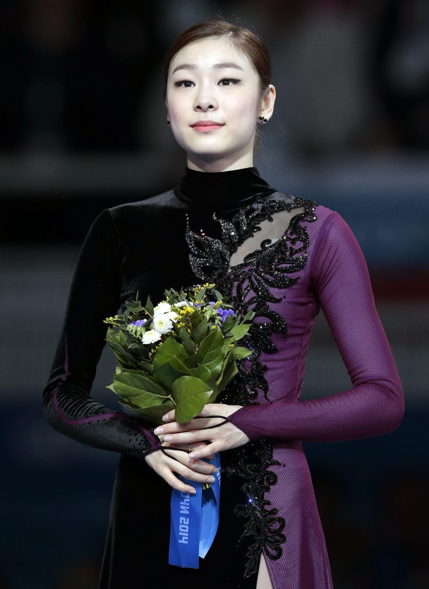 Yuna Kim of South Korea poses on the podium after placing second in the women's free skate figure skating finals at the Iceberg Skating Palace during the 2014 Winter Olympics, Thursday, Feb. 20, 2014, in Sochi, Russia. (AP Photo/Ivan Sekretarev)