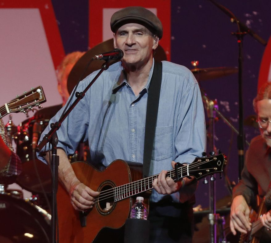 FILE - In this May 30, 2013 file photo, James Taylor performs at the Boston Strong Concert: An Evening of Support and Celebration at the TD Garden, in Boston. The singer-songwriter is starring in a television ad for an environmental group urging North Carolinians to challenge efforts to allow natural gas exploration through hydraulic fracturing in the state where he grew up. The Natural Resources Defense Council said the ad began running Thursday, Feb. 20, 2014.  (Photo by Bizuayehu Tesfaye/Invision/AP, file)