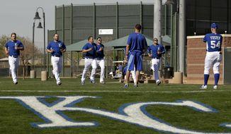 Kansas City Royals catchers run  during morning workouts at spring training baseball practice, Saturday, Feb. 15, 2014, in Surprise, Ariz. (AP Photo/Tony Gutierrez)
