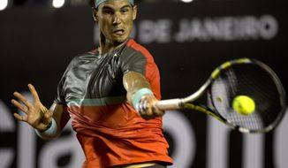 Rafael Nadal, of Spain, returns the ball to Albert Montanes, of Spain, at the Rio Open tennis tournament in Rio de Janeiro, Brazil, Thursday, Feb. 20, 2014. (AP Photo/Silvia Izquierdo)