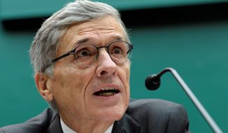 FCC Chairman Tom Wheeler eyes new rules that threaten the survival of black-owned TV stations. (Associated Press)
