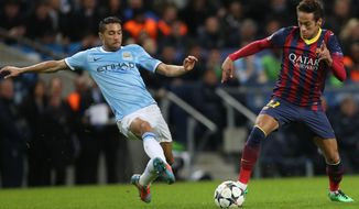 Barcelona's Neymar fights for the ball Manchester City's Gael Clichy, left, during their Champions League first knock out round soccer match at the Etihad Stadium, Manchester, England, Tuesday Feb. 18, 2014. (AP Photo/Jon Super)